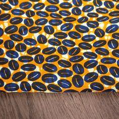 Tissu  wax pagne coton orange/bleu/ecru/ motif caurie.
