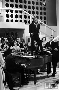 Sammy Davis, Jr. sings and dances on a piano on the TV show The Big Party (October 1959).