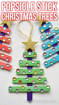 These popsicle stick Christmas trees are SO EASY to make and they're so beautiful! The kids LOVED decorating them! Such an awesome Christmas craft idea! Hand Crafts For Kids, Christmas Crafts For Kids To Make, Christmas Ornament Crafts, Xmas Crafts, Kids Christmas, Christmas Decorations For Kids, Santa Crafts, Christmas Wreaths, Holiday Decor