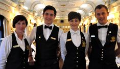 Restaurant uniform: Black waistcoats, black trousers, women have white bow ties and the men have black bow ties. Hotel Jobs, Hotel Staff, Waiter Uniform, Black Waistcoat, Hotel Uniform, Restaurant Uniforms, Trans Siberian Railway, White Bow Tie, Staff Uniforms