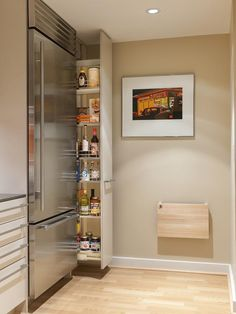 Hidden Pantry-wondering how close to the wall it is or is there enough room to fit behind in to get items from the backside of the pantry.