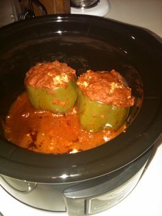 Stuffed Peppers  4 large green peppers  1 pound ground meat (I used 1/2 spicey Italian Sausage and 1/2 ground beef)  1 1/2 cups cooked rice (I used brown rice but a pilaf or long grain would be fabu)  1 small yellow onion chopped  1 tbs minced garlic  1 tbs Italian seasoning (you can use any type of seasoning you enjoy)  1 jar pasta sauce