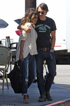 In love: Halle Berry (left) and husband Olivier Martinez (right) looked very much in love during a breakfast date in West Hollywood, California on Saturday