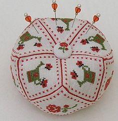 rose, watering can and basket cross stitch biscornu