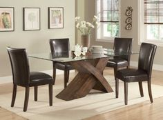 103051 Nessa Large Scaled X Base Dining Table with Glass Top by Coaster by Coaster Home Furnishings. $611.62. Composition: Wood and glass. Style: Contemporary. Brand New From An Authorized Coaster Dealer!. Case Detail: Smooth and clean lines.. Finish: Brown. Make a bold statement in your casual or formal dining room with this Nessa Large Scaled X Base Dining Table with Glass Top - Coaster Co It features a large scaled X base design with rectangular glass top The base i...