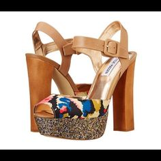 Flash SALESteve Madden Floral print Platforms Steve Madden Floral Print Platforms Shoes . This super Chic platform shoes are perfect as a statement shoes .  The front part of the platform has multi color glitter and the back heel is wood , the strap of the shoe is a tan color and the front forward strap has a floral print . Only worn once in carpet . This shoes are size 10.  ⛔️No Trades . Steve Madden Shoes Platforms