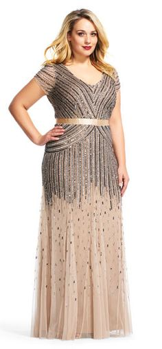 Perfect for your next occasion, this stunning sequined cap-sleeve bodice gives way to a gracefully flared skirt.