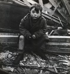 """""""I was told he had come back from playing and found his house a shambles—his mother, father and brother dead under the rubble…he was looking up at the sky, his face an expression of both confusion and defiance. The defiance made him look like a young Winston Churchill. This photograph was used by IBM to publicize a show in London. The boy grew up to become a truck driver after the war, and walking past the IBM offices, he recognized his picture."""" WW 2"""