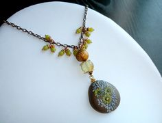 Calming Olive Jade and Copper tone necklace with by Peelirohini, $68.00