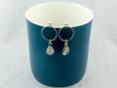 circular silver post earrings with moonstones  by LaPetiteMaisonBijoux on Etsy, €22.50