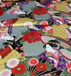 Kimono Girl 20B    €17.00    Width: 110cm. Price: 17 Euros per metre.     A richly coloured fabric with gold featuring traditional Japanese geisha in kimono. Enter the quantity you require in metres.    Minimum purchase: 0.2m. Increments: 0.1m.