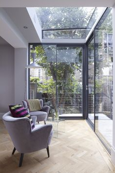 A contemporary and sophisticated window inspiration idea. The purple upholstery is bautiful next to the light