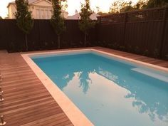 We just finished this garden. Jarrah decking with Travertine coping tile..