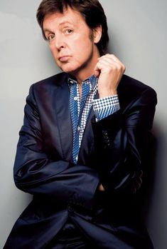 """May 2008. Sir Paul McCartney: I went for a walk, to experience life for a minute. There's a guitar shop I like to visit, so I went there & got chatting to the guy who works there. He said he had a left-handed mandolin to show me, & I ended up buying it. At home, I started stomping around the kitchen, playing this little instrument, just enjoying myself. I sang, """"Everybody gonna dance tonight"""" and my little girl came running in & started dancing, so I fell in love with the song."""