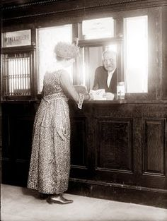 This picture is from 1918, and shows a woman in the Post Office. I miss that beautiful old woodworking.