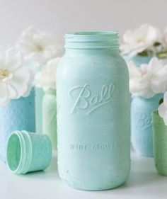 Distressed Chalkboard Mason Jars: Plain old mason jars get a quick upgrade: Coat jars with a layer of your favorite pastel paint, let dry, and rub all over with sandpaper to create an antiqued look. Fill each jar with flowers for an easy, rustic centerpiece.
