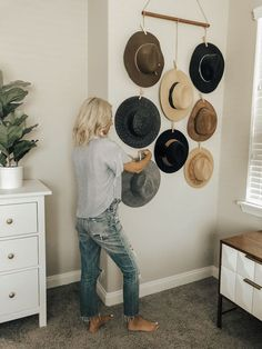 First of all I am definitely a crazy hat lady and truly believe that wearing adding a hat to any outfit instantly makes it better. With that being said my hat collection really started to… hats style DIY HAT WALL TUTORIAL - Jaclyn De Leon Style Diy Wall, Wall Decor, Hat Storage, Crazy Hats, Home Organization, Organizing Hats, Scarf Organization, My Room, Home Projects