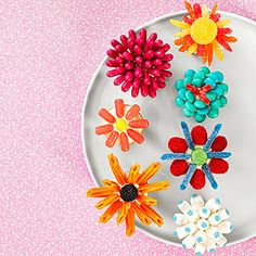 Mother's Day Bouquet: What's better than candy and flowers on Mom's special day? How about candy flowers? For each, start with a generously frosted mini cupcake, then press various candies (gumdrops, M&M's, licorice twists, mini marshmallows, and more) into the frosting.