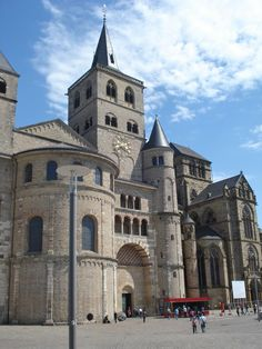 OTTONIAN ARCHITECTURE - Cathedral of Trier, 11 and 12th century, Germany. The cathedral was built in the 4th century during the age of Constantine. It was remodelled and built again in the 11th century with a west front containing a central apse.