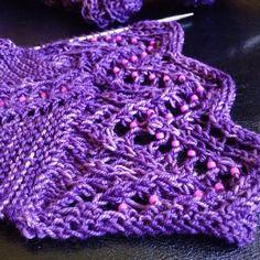 Still feeling rough but managed some border repeats while binging on The Paradise #littlenutmegproductions #meghanjoneslnmp @siviaharding #siviaharding #makersofinstagram #knit #knitlove #knitters #knitting #knittersoftheworld #knittersofinstagram #knittingaddict #knittingpattern #niome #knitdesign #knitdesigner #knittingpattern #design #designer #beadedknitting #beads #lace #laceknitting #pink #purple #malabrigo #shawl #sockyarn