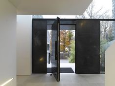 :: INTERIORS :: bold black steel pivot door, lovely corridor, House M by Titus Bernhard Architects, featured on contemporist #interiors