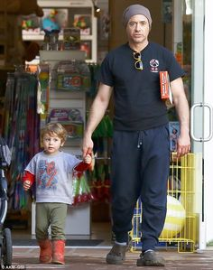Daddy's little superhero! Robert Downey Jr. was seen leaving Toy Crazy in Malibu in Los Angeles on Thursday with his youngest son, two-year-old Exton with a set of Justice League figurines.. --can we just pretend we don't know that Iron Man wears Crocs in his downtime?  :P