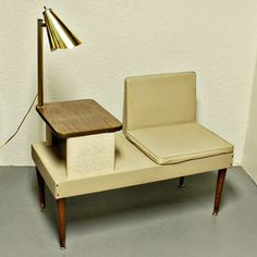 """Vintage telephone seat """"Gossip Bench"""".  I love the built in lamp!"""