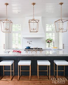 White kitchen with dark blue wainscoted island donning a gray quartzite countertop fitted with a sink paired with a vintage brass faucet lit by Darlana Medium Lanterns hung from a white plank ceiling. Home Decor Kitchen, New Kitchen, Home Kitchens, Kitchen Dining, Kitchen Ideas, Updated Kitchen, Brass Kitchen, 2017 Kitchens, Kitchen Pendants