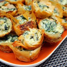 Spanakopita Bites: A perfect bite of spinach and cheeses nestled in flaky, buttery phyllo…