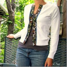 how to transform a sweater into a cardigan. I wish I was handy enough to do this.