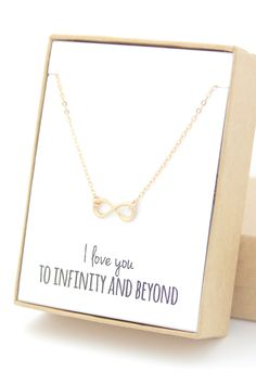 Weve brought back this necklace with a new and improved infinity charm. It is slightly different that the first picture, but you can see exactly what it looks like in the 2nd and 3rd pictures. THIS LISTING INCLUDES • A tiny gold infinity necklace • Gift-wrapped with note in box and name tag on outside of box   MATERIALS • 14K gold-filled chain and findings (not just plated - perfect for sensitive skin) • 14K gold-filled infinity charm   SIZE • Pendant is about 11x5mm • Length: modeled at 16…