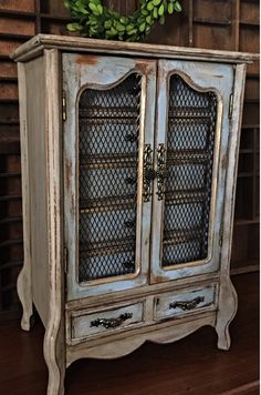 Vintage French jewelry armoire painted in Annie Sloan chalk paints in colors Coco and Louis Blue. Heavily distressed an accent it in dark wax and sealed and clear wax drawers and door trim accented in gold gilding wax. There are six drawers all in original gold velvet fabric. The bottom drawer has sections and ring rolls. Measures: 16.5h x 11w x 7d. This is a music box that plays Laras Theme from Dr Zhivago.