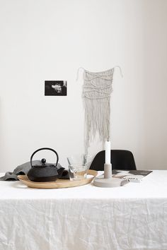 Macrame wall hanging, crisp white, greys and floaty linen in a bloggers home