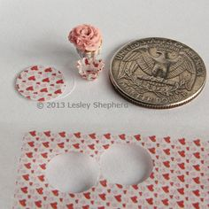 Tissue printed with tiny hearts used to make baking cups in dolls house miniature scale.  Can use this method to print anything (miniature sewing patterns for Barbie?)
