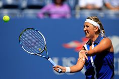 Victoria Azarenka Photos: US Open: Day 4. Victoria Azarenka of Belarus returns a shot against Christina McHale of the United States during their women's singles second round match on Day Four of the 2014 US Open at the USTA Billie Jean King National Tennis Center on August 28, 2014 in the Flushing neighborhood of the Queens borough of New York City.