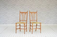 A pair of English Oak kitchen chairs with newly woven seats