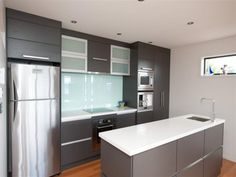 Awesome kitchen for a small space. The cabinets are wonderful - I would go with a different refridgerator.