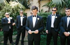 groomsmen in black tuxedos with bowties