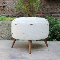 Round ottoman upholstered with vintage hand woven hemp rug fabric is linen. Brand new wooden stool frame with 4 legs, stool is padded for extra comfort. Transforming traditional textiles into modern collectible furniture. Would be perfect way to add some color to a room. Details ■ Dimensions: 18H×21W×21D ■ Fabric: Vintage Hemp Rug (Linen) ■ Color: White Fabric, Brown embroidery ■ Stitching and Wood parts are brand new This Item is Made to Order (Photo is an example) ■ Processing time 4-6…