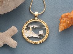 Cut Maine Quarter Pendant  https://www.etsy.com/listing/211561894/lighthouse-pendant-and-necklace-jewelry