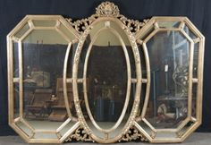 THREE PANEL VENETIAN STYLE MIRROR WITH GOLD COLORED AROUND EDGES OF MIRROR. VERY HEAVY AND READY TO HANG. MEASURES 44 X 60.
