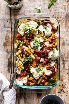 Caprese Pesto Pasta Bake, a fresh and easy spring dinner the entire family will enjoy. Pasta tossed with slowly roasted cherry tomatoes, basil pesto, burrata cheese, and prosciutto. All baked until the cheese is melty Vegetarian Recipes, Cooking Recipes, Healthy Dinner Recipes, Low Carb Recipes, Recipes With Pesto, Easy Recipes, Pesto Pasta Bake, Caprese Pasta, Pasta Bake Recipes