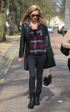 Kate added a bit of glamour to a pub trip with her Chanel handbag, but the rest of the outfit stayed casual. A checked shirt and long coat topped the omnipresent skinny jeans and black moto boots. -- Kate Moss | POPSUGAR Fashion