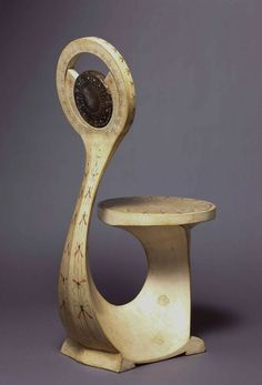 cobra chair, 1902, Oak, vellum, bronze, continous curve with dragonfiles. insects are an inspiration from biology