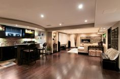Love this fireplace!!!  A Basement With Room to Entertain - contemporary - Basement - Ottawa - Just Basements