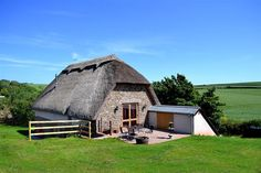 Surrounded by fields and found in Devon. Wouldn't you love a peaceful cottage break in the UK countryside?