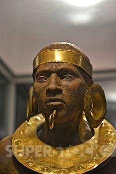 Costa Rica, San Jose, Pre-Columbian Gold Museum, Figurine of warrior. Political and religious leadership rolls represented. Recreation of Pre-Columbian communities