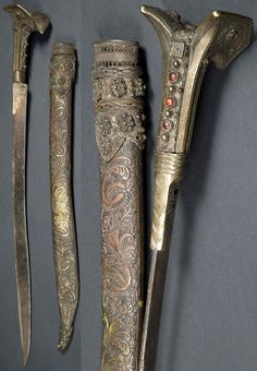 "Ottoman yataghan, the short-sword with characteristic brass flaring pommel, the grip and pommel with inset carnelian, the blade with some oxidation with remains of a gilded inscription to one side (illegible) and a seal of Suliman to the other. The Scabbard with elaborate basket-woven brass locket with attached florets, the body with foliate patterns terminating in a shape in the form of a fish, 28"" long sword, could use a good cleaning, but a superb example. Probably late 18th-early 19th C."