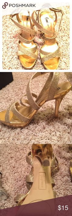 Strappy gold sparkly heels Worn once to prom! The sparkly gold heels are in great condition! Make an offer in the comments! Shoes Heels