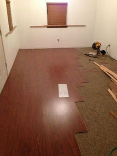 DIY laminate flooring over existing carpet. Our new retail space had old dirty Berber carpet which acts as the pad for floating laminate flooring. Brazilian Cherry color and it looks great.   Grand Opening of GHC 2.0 is 6/15/13 at 3310 S Yale Ave Tulsa, OK 74135